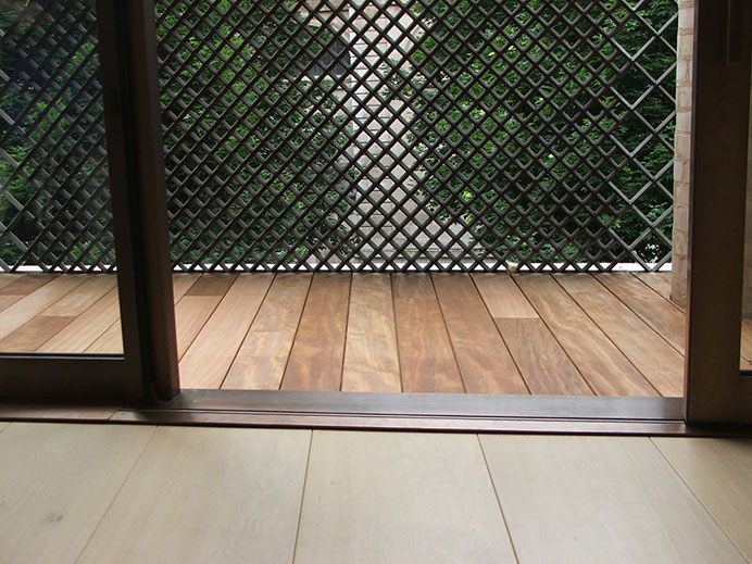 Transition of inside to the outside terrace with decking at Cottage place