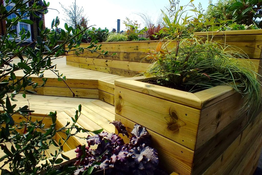 Code III treated redwood decking and planters used at Telferscot School in London