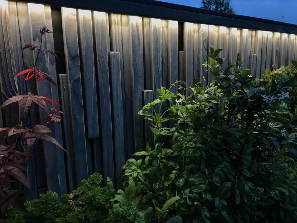 Charred Accoya Fence at night