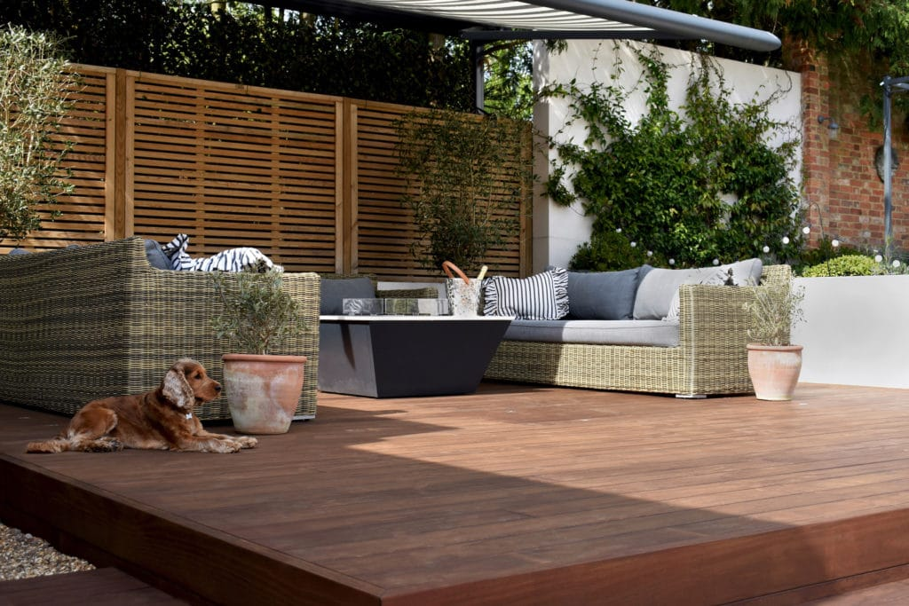 kebony radiata decking protected with Owatrol with relaxing dog